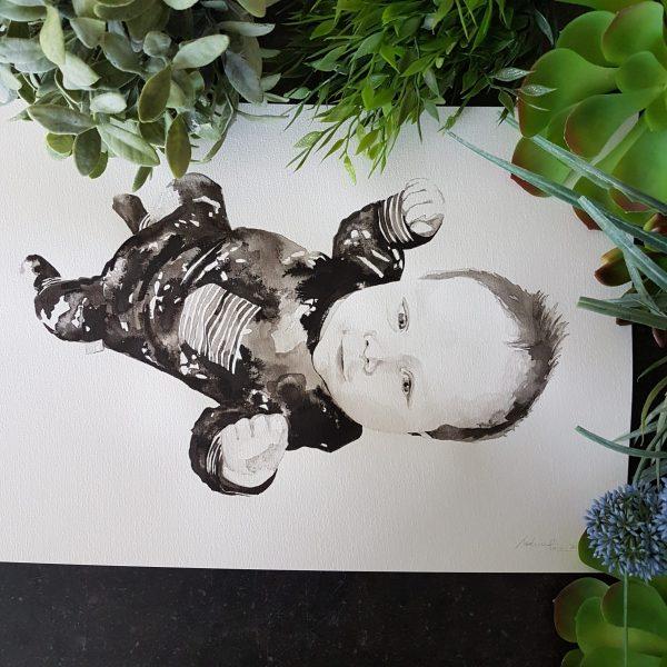 vrolijk baby portret in inkt