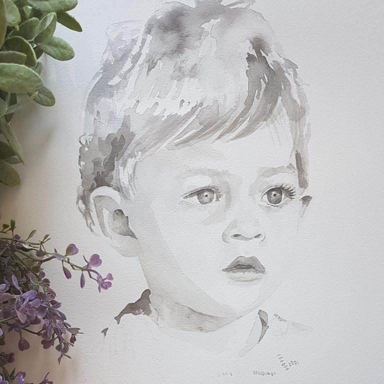 kindportret in zachte wassing van een peuterjongetje