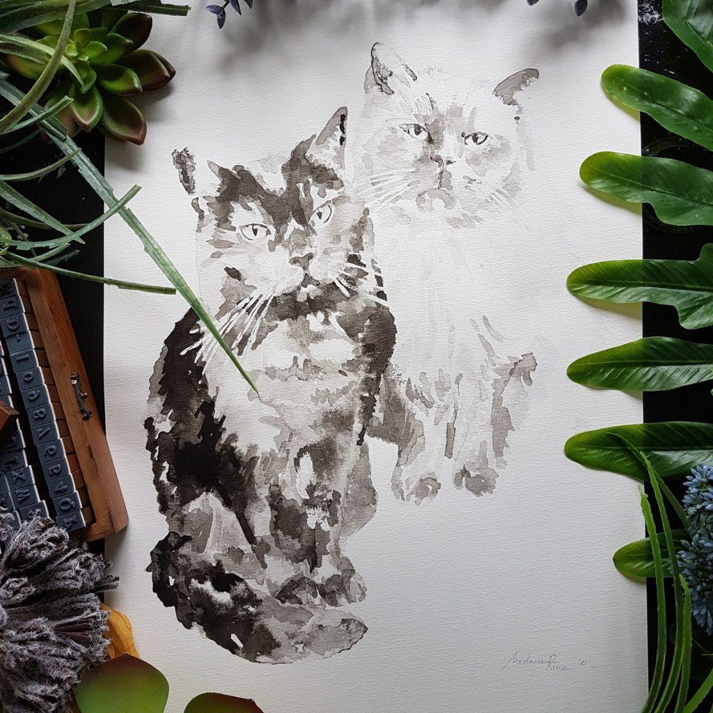 kattenportret van een zwarte en een witte kat